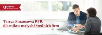 Tarcza Finansowa PFR dla mikro, małych i średnich firm. Na zdjęciu kobieta i mężczyzna rozmawiają w biurze.